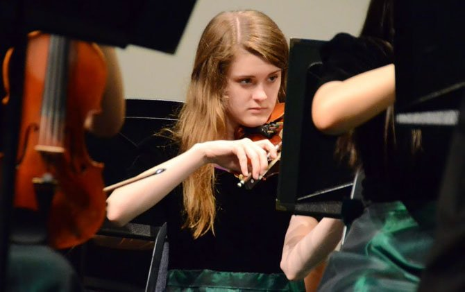 "Natalie Fahlberg, this year's president of the Tri-M Honor Society, plays the violin during the senior-exclusive performance of ""Transformers."""