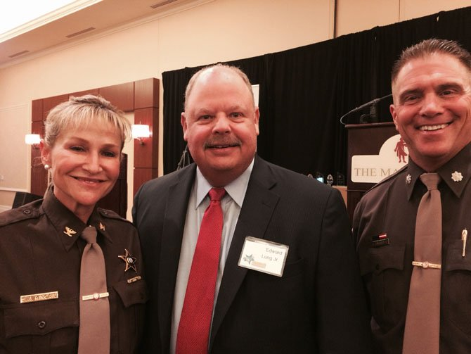 Fairfax County Sheriff Stacey Kincaid, County Executive Ed Long and Lt. Col. Kevin Andariese at the Fairfax County and FCPS Celebrate Partnerships Awards Ceremony on May 29, 2014 at the Mason Inn in Fairfax.