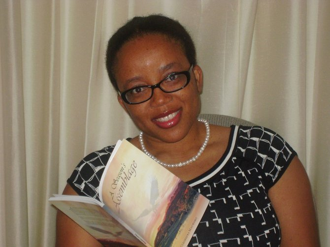 """Cleo Magwaro with her book, """"A Season's Assemblage."""""""