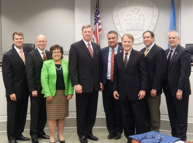 City Council and the chief: (From left) are Jeff Greenfield, Steve Stombres, Ellie Schmidt, Rick Rappoport, Mayor Scott Silverthorne, David Meyer, Dan Drummond and Michael De Marco.