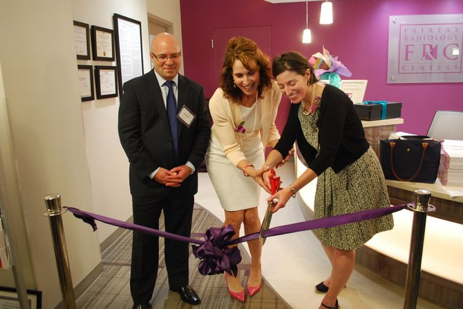 Robert Thompson of General Electric Healthcare, Nancy Cappello of Are You Dense, Inc. and Elise Berman of Fairfax Radiological Consultants cut the ribbon to the newly renovated Breast Diagnostic Imaging Center.