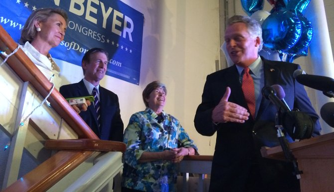 Gov. Terry McAuliffe congratulates former Lt. Gov. Don Beyer on his victory in the Democratic primary.