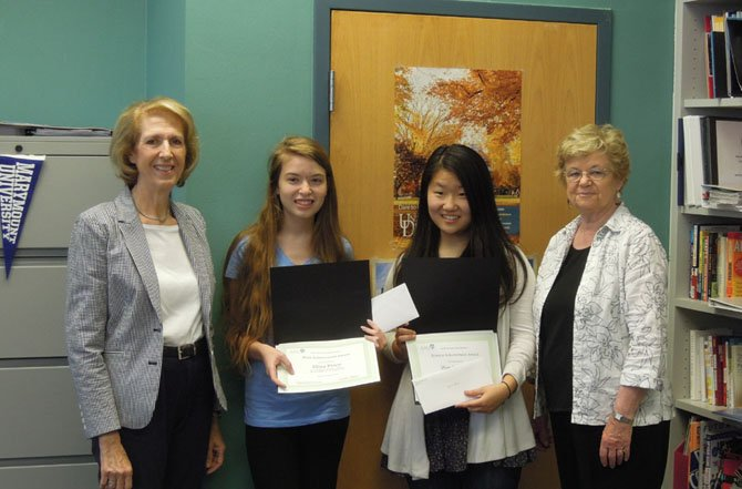 Eliza Price, second from left, and Lauren Yeom, second from right, juniors at McLean High School, are shown receiving their academic achievement awards from the McLean Area Branch of AAUW. The awards were presented by Peg Stotz, far right, incoming co-president of the McLean Area Branch, and Judy Page, far left, STEM coordinator for the branch.