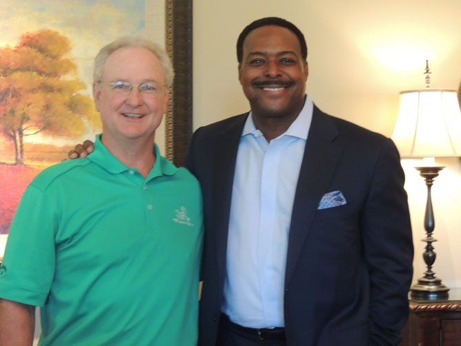 Chairman of the Board of Directors of The First Tee Pat Price with emcee Leon Harris of WJLA Channel 7 TV.
