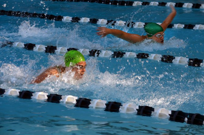 Emily Landeryou and Madeline LaPorte race to a one-two finish for Glade in the girls' 50-meter butterfly event.