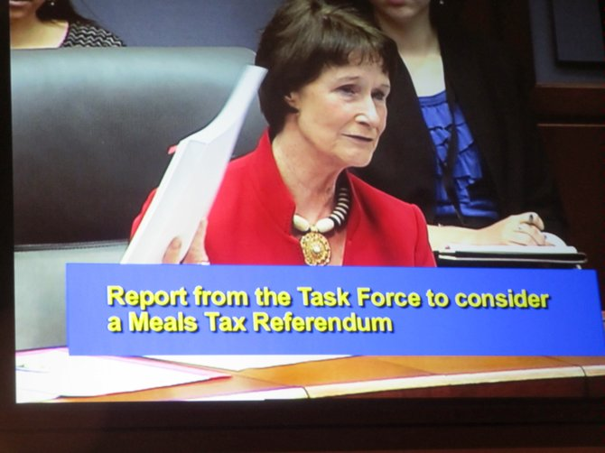 Sharon Bulova, Chairman of the Fairfax County Board of Supervisors, holds up the 170-page final report of the Meals Referendum Task Force. The board deferred any action in order to review the final report in more depth, Bulova said.