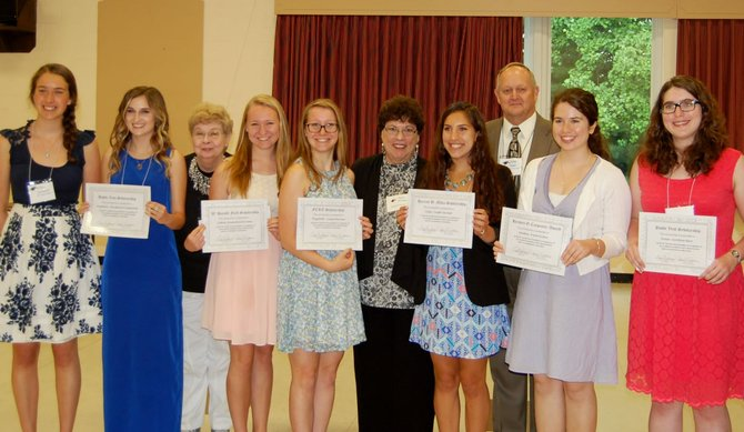 The recipients of scholarships from the Fairfax County Retired Educators gather at a luncheon honoring their accomplishments on June 12. All of these students have plans to obtain a teaching career and some are hoping to return to teach in Fairfax County. From left: Talia Schmidt, a recipient of last year's scholarship, Kimberley Drummond, Billie Johnson, president of FCRE, Sydney Kirwan, Elizabeth McCune, Phyllis Rittman, Julia Gurdak, John Dent, incoming president of FCRE, Sandra Richie, and Anna Barr. Not pictured: Scholarship recipient Emily Colon.
