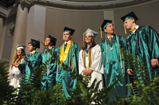 Senior SGA representatives Katharine Altman, Timothy Claude and Brian Plunkett join class officers treasurer Will Gent, secretary Courtney Cuppernull, vice president Edric Wung and president Jonathan Meyer on stage.