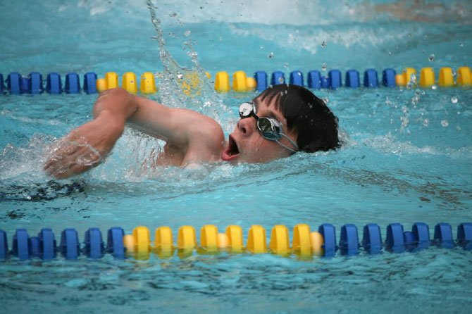 Shouse Village swimmer Andrew Zarazinski competes for the Sharks in the boys' 13-14 50-meter freestyle.