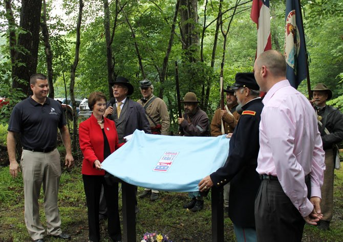Officials unveil the Wolf Run Shoals Civil War Trails Marker at a dedication ceremony on June 21 in Clifton.