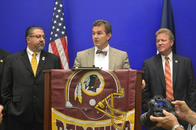 "State Sen. Chap Petersen (D-Fairfax – center), stands with Republican Delegates David Ramadan of Loudoun (left) and Jackson Miller (Manassas) right, during a news conference at the Capitol in Richmond Monday, June 23, announcing the formation of the ""Redskins Pride Caucus."""