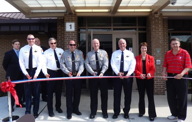 About to cut the ribbon are (from left) Station 21 Volunteer Chief Jack May and Volunteer Deputy Chief Jonathan Wood, Police Capt. John Naylor Jr., Police Chief Ed Roessler Jr., Fire Chief Richard Bowers, Supervisors Chairman Sharon Bulova and Sully Supervisor Michael Frey.