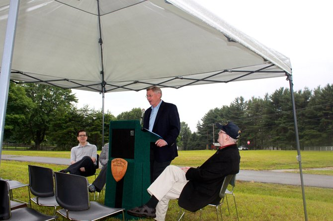Dranesville Supervisor John Foust speaks before the roll-top observatory groundbreaking Saturday.