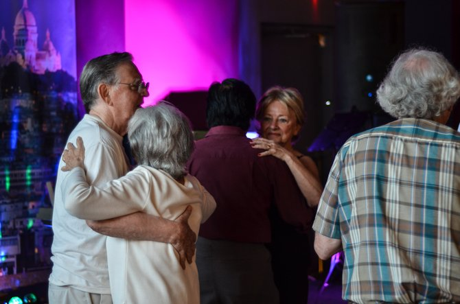 Couples enjoy dancing at Lake Anne's Café Montmartre. The restaurant's monthly musical events draw a good audience of local residents.