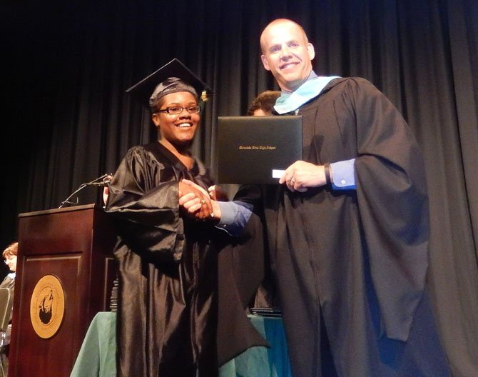 Shawnea Owens gets her diploma from Principal Dave Jagels.