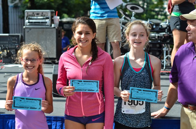 Winners of the female age group ages 1 to 14 were Sarah Daniels of Burke, Emily Landeryou of Reston, and Abby Church of South Riding, Va.