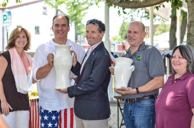 Melissa Landau, Potter's Fire owner Mike Faul, Doug Landau, Green Lizard owner David Meyer, and Herndon Florists owner Anne Harvey pose for photos at the July 7 award ceremony for the first Potter's Fire Throwdown contest.