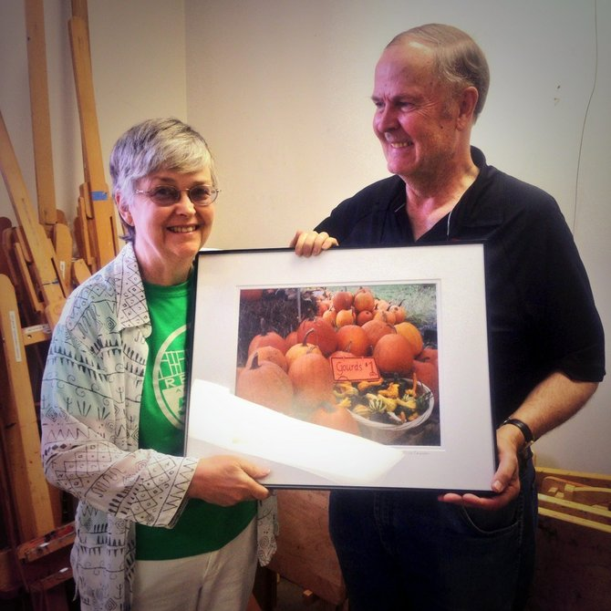 "Anne Emerson and her husband display her photo ""Herndon Rotary Club Pumpkin Stall II"". The 2014 photo exhibit displays the works of twenty-five local photographers, who took photos within the corporate limits of the Town of Herndon."