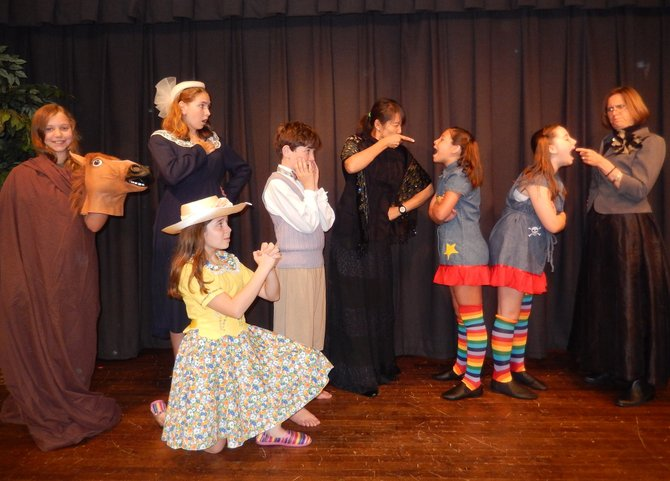 Posing in character are (standing, from left) Lizzie Bayer, Sierra Hoffman, Owen Grannis, Sharon Petersen, Bella Lanoue-Chapman, Maggie Slivka and Judy Zakreski, and (kneeling) Lourdes Navarro.