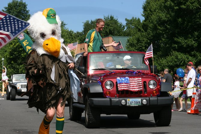 The mascot for the Great Falls Eagles rugby team danced alongside the team car.