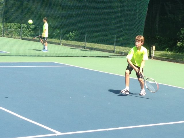Jacob Kohlmayer, 11, of Chesterbrook Elementary and the Chesterbrook Tennis Team supplies his best backhand shot in a match against Sudley Tennis Club on July 2.
