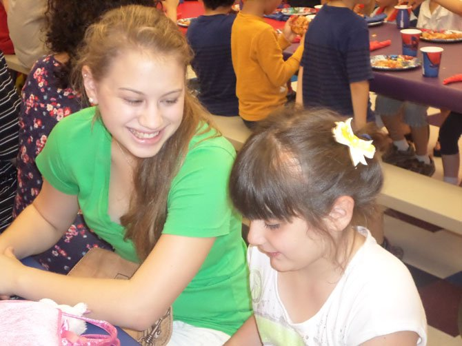Friendship Circle teen volunteer Allie Wiener plays with her buddy Sophie Gottfried. Friendship Circle pairs special needs children with teenage volunteers who mentor the youngsters.