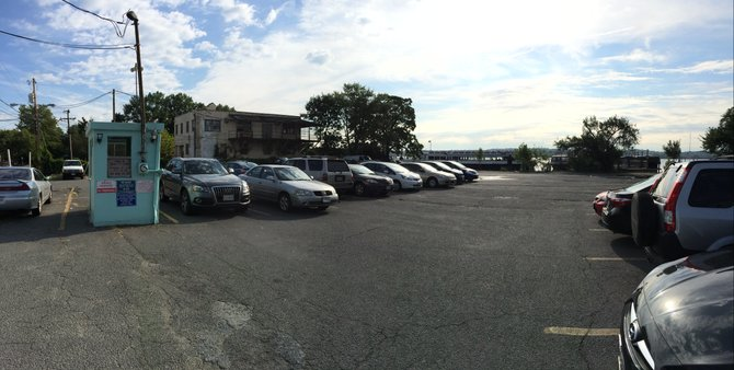 The city already owns the old Beachcomber Restaurant and one third of this parking lot, which were purchased by the city using open space funds in 2006. Now the City Council is about to consider an ordinance that would finalize the sale of the rest of the parking lot, which will cost about $5 million.