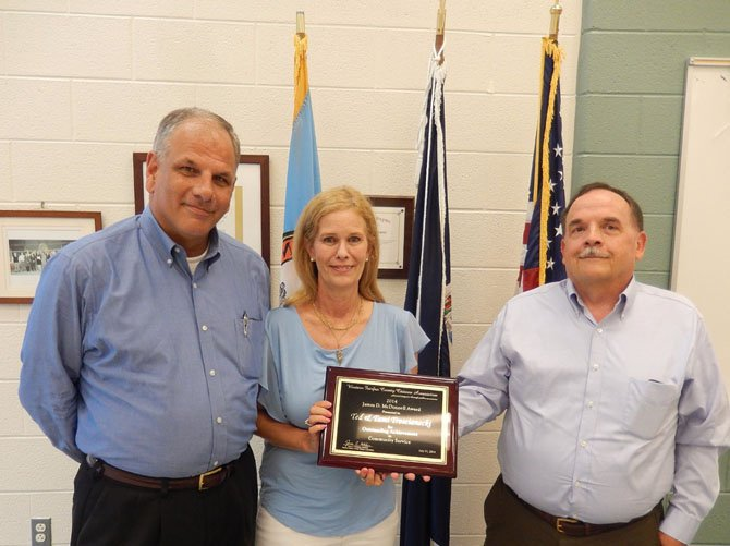 From left: Ted and Tami Troscianecki receive the James D. McDonnell Award for outstanding community service from Jim Katcham.