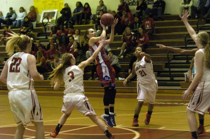 Former T.C. Williams guard Angie Schedler attempts a shot against Annandale during her senior season.