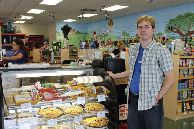 Matt O'Leary, an employee at the natural pet food store Felix & Oscar in Springfield, stands by the store's wide selection of fresh treats for dogs and cats.
