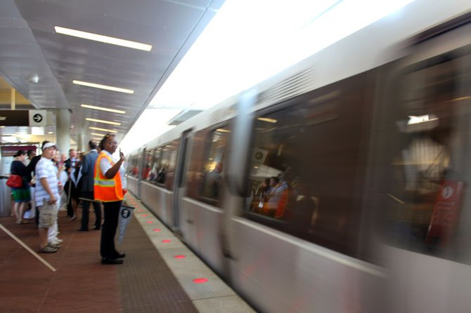 The first public Silver Line rail cars leave the Wiehle-Reston East station.