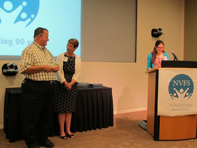 Mary Agee, NVFS president and CEO, and Karen Horowitz, director of volunteer and internship engagement,  present Ralph Lickey with the Presidential Award for Community Volunteers at the agency's annual meeting, June 12, at the Capital One headquarters.
