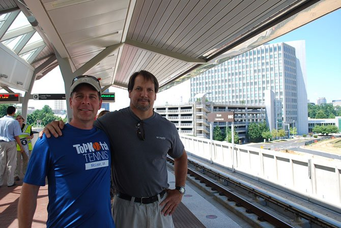 """Darren Ewing of McLean and Andy Marshall of Great Falls wait on the platform for the """"inaugural ride"""" on the Silver Line, Saturday, July 26."""
