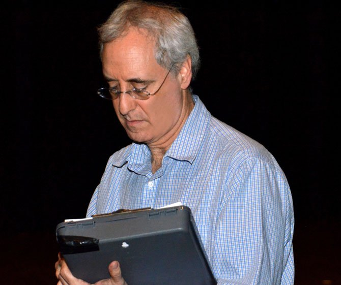 Robinson Director Chip Rome taking notes during a rehearsal.