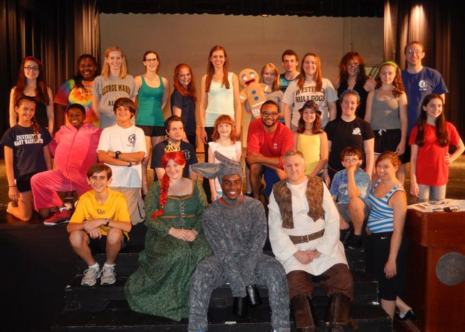"In costume are (from left) Jennifer LePaige (Princess Fiona), Devyn Tinker (donkey) and Glynn Cosker (Shrek) with some of the Summer Stars actors before rehearsing the ""Freak Flag"" dance number."