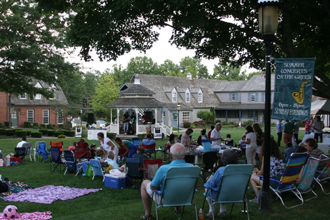Dozens of Great Falls residents gathered in the Village Centre to listen and enjoy music at the close of the weekend.