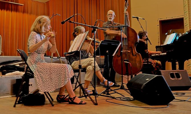 The band (from left) Barbara Heitz, Andrea Hoag, Ralph Gordon and Liz Donaldson perform Sunday, Aug. 3, at the Waltz Dance in the Spanish Ballroom at Glen Echo Park.