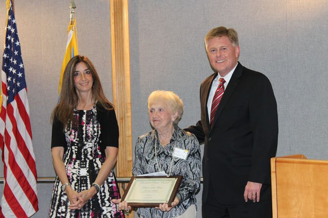 Norma Heck (center) was recognized by the Board of Supervisors on July 29 for her service to the community. She is pictured here receiving an award for being the 2014 Braddock District Citizen of the Year.