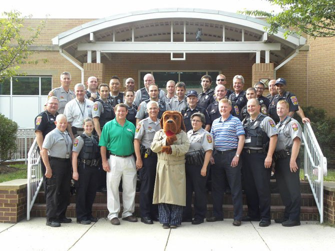 Fairfax County Police Officers, McGruff the Crime Dog, and Supervisors John C. Cook (R- Braddock) and Pat Herrity (R-Springfield) visit Fairfax County neighborhoods, Tuesday, Aug. 5, for National Night Out.