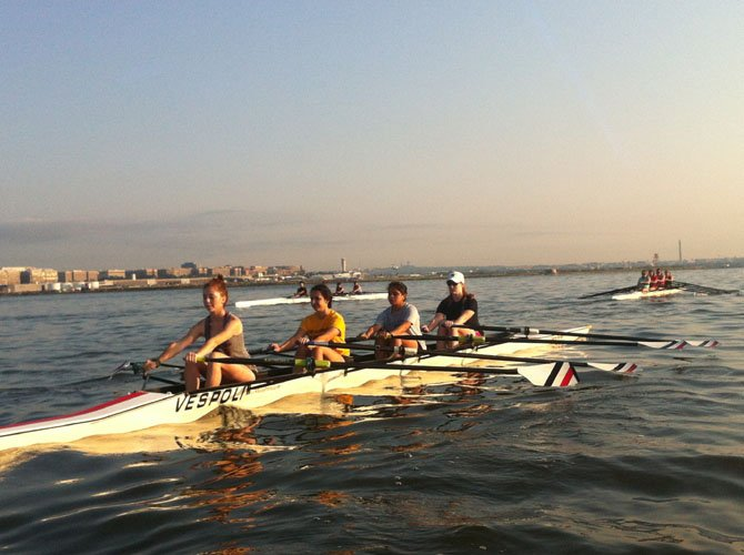 <cl>The quads line up for their 500 sprint to show off their sculling skills at the Blue Plains Sprints on Aug. 2.