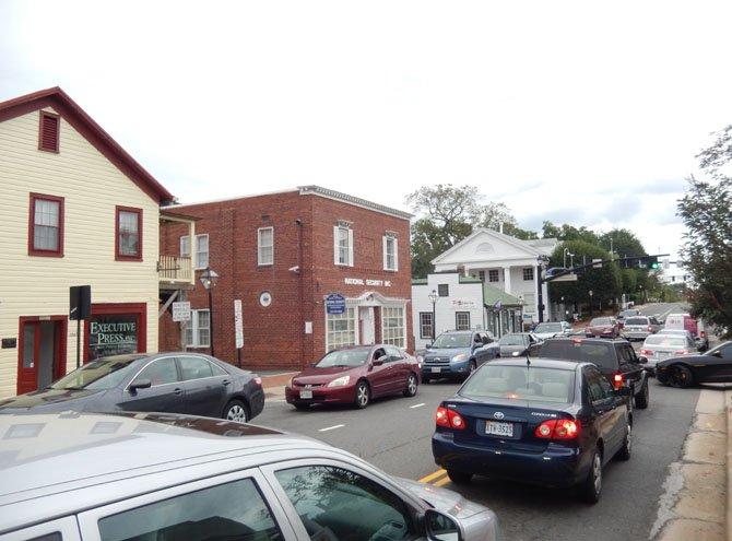 Monday evening traffic travels two ways on Fairfax's Main Street.