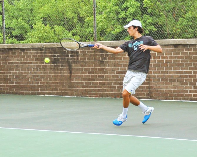 Josh Hublitz hits a forehand on one of the outdoor hard courts at Jack Schore Tennis, which operates out of Regency in McLean.