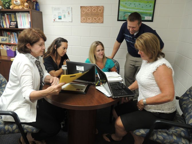 From left: Laurel Hill Elementary Principal Suzie Montgomery, School-Based Technology Specialist Tiffany Duncan, Special Education Teacher Susie Alonso, Assistant Principal David Stratuik, and Special Education Procedural Support Liaison Jean Massie work together on plans in the remaining days of August.