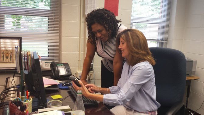 From left--Assistant Principal Janice Dalton and Principal Maureen Boland go over plans for the upcoming school year in Boland's office at Rolling Valley Elementary School.