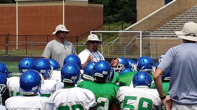 First-year South Lakes football coach Trey Taylor talks to the Seahawks after a recent practice.