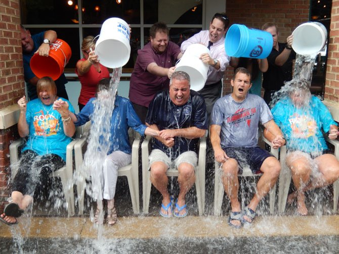 Board of Supervisors Chairman Sharon Bulova gets drenched. (From left) are Jo Ormesher, Sharon Bulova, Scott Silverthorne, Chap Petersen and Beverly Myers. Petersen's daughter, Eva, a Fairfax High sophomore, had the honor of dousing her dad with ice water.