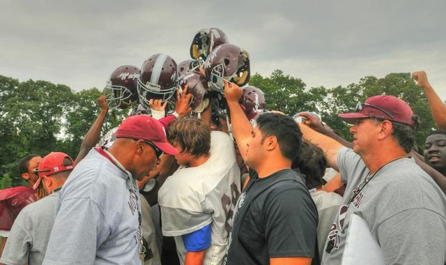 Head coach Barry Wells, left foreground, and the Mount Vernon football team will open the 2014 season against Edison on Aug. 28.