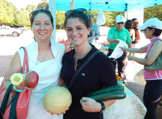 (From left) are Sarah Keally and Whitney Kazragis with their produce purchases.