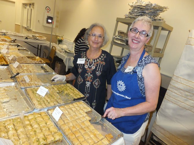 Holy Transfiguration Melkite Greek-Catholic Church volunteers sell sweets hand-made by church members. The festival will sell 12,000 pieces of sweets over the two-day festival on Labor Day weekend.