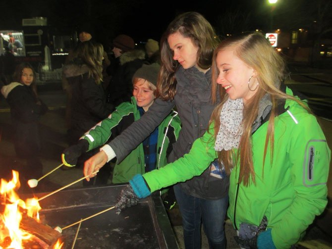 The Newell family of Vienna roasts marshmallows over an open fire during the first annual First Night Vienna celebration, held December 31, 2013, along the Church Street corridor.
